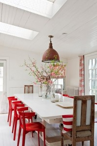 White Dining Room with Red Accents #white #red #dining #room #table #chairs #vaulted #ceiling #skylight