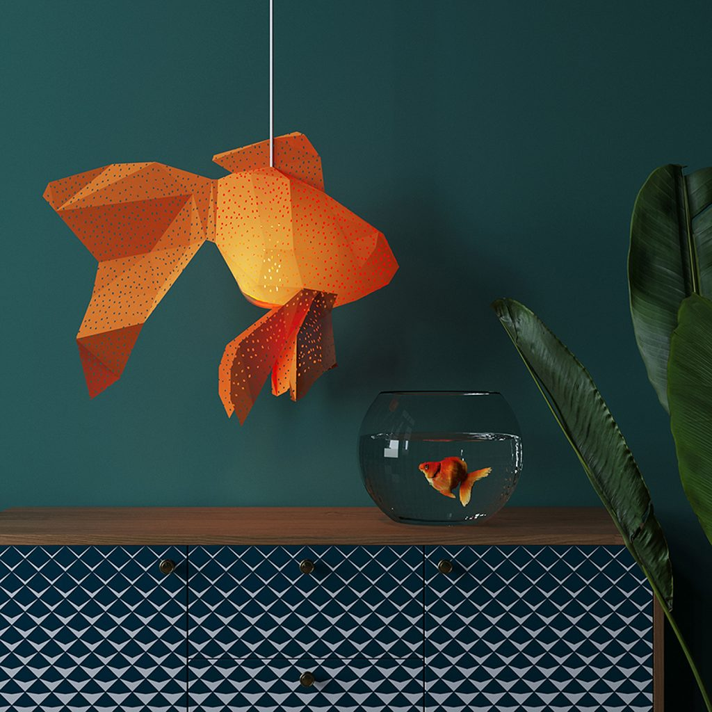 Goldfish lamp above goldfish bowl