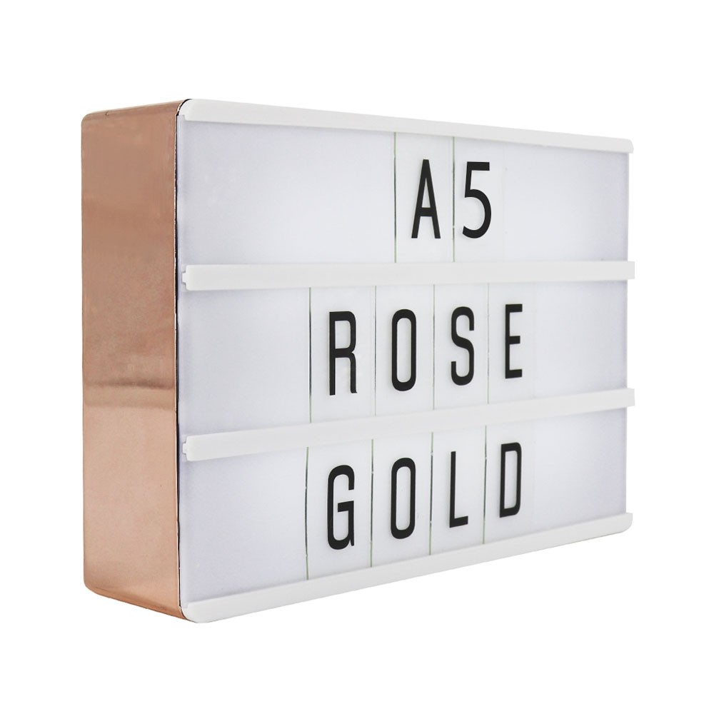 rose gold lightbox sign a red candy